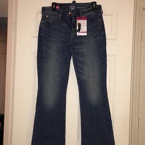 Women's mid rise boot cut jean